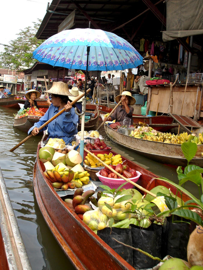 Thai Food Boat with Umbrella at Floating Market royalty free stock photography