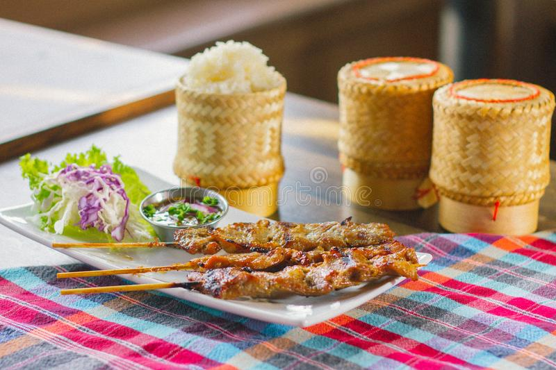 Sticky rice with pork skewer royalty free stock photo