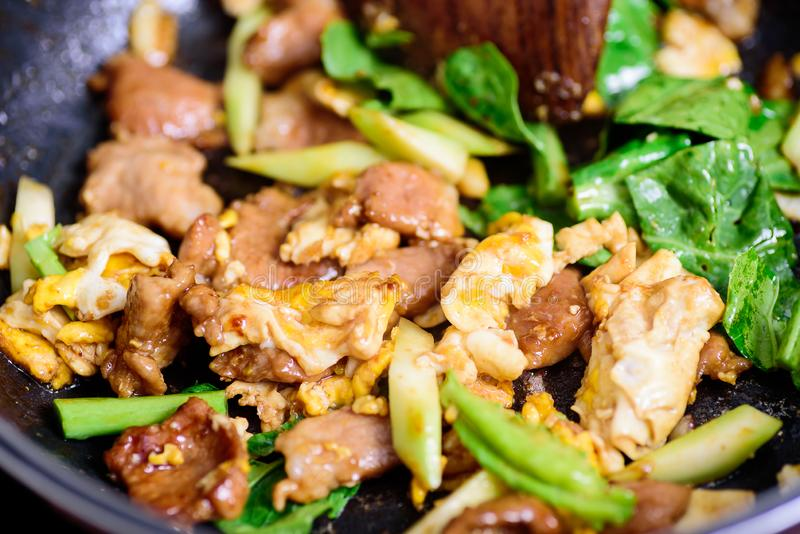 Stir fried rice noodle in soy sauce Pad See Ew. Thai food cooking, stir fried rice noodle in soy sauce Pad See Ew royalty free stock photo