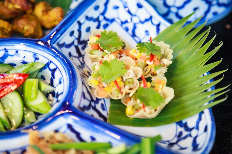 Thai Food Cuisine, Kratong Thong Herb Minced Pork or Chicken and Sweet Corn in Pastry, Golden Shell Cups or Baskets on dish royalty free stock images