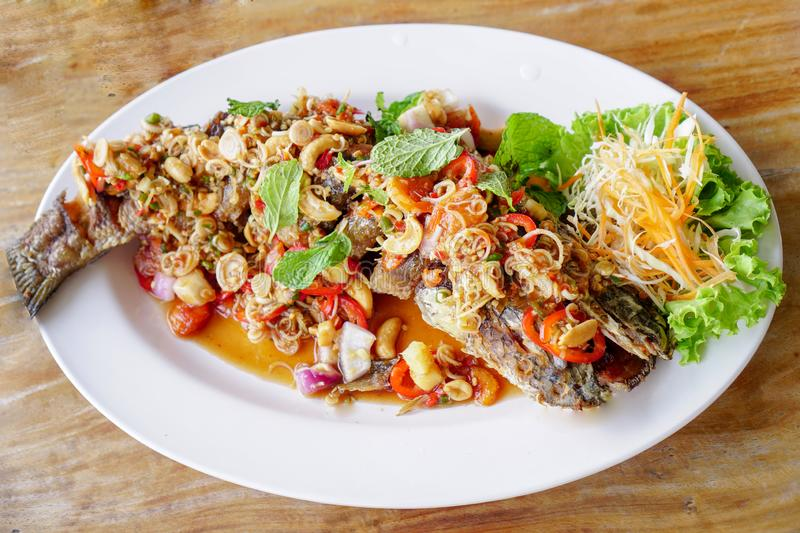 Thai Food,Snakehead fish on a white plate royalty free stock photography