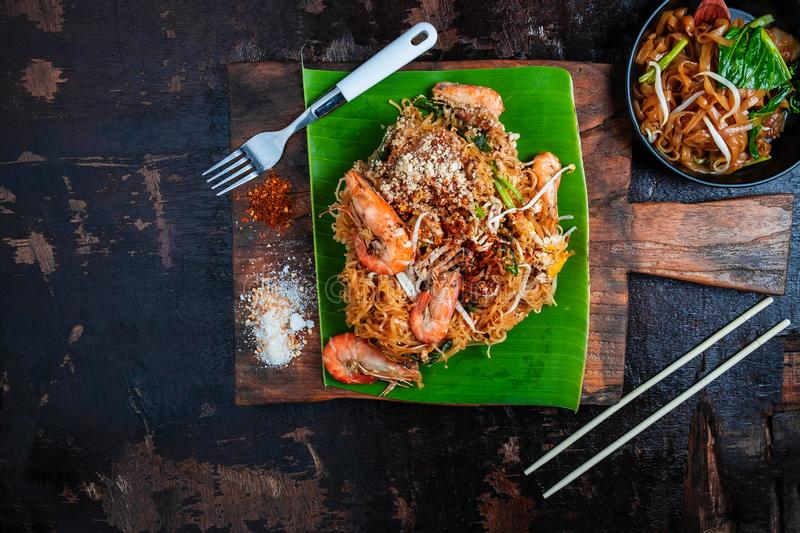 Thai food Thai Fried Noodles on wooden table stock photos