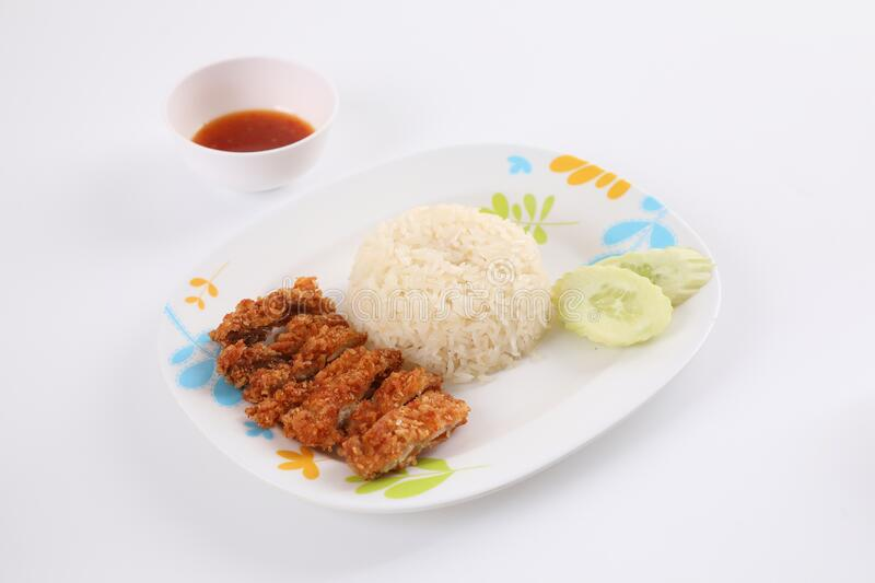 Thai food gourmet fried chicken with rice , khao mun kai in wood background stock photos