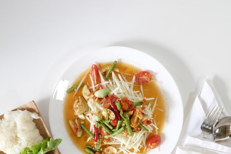 Som tam thai, green papaya salad on white table with space. stock image
