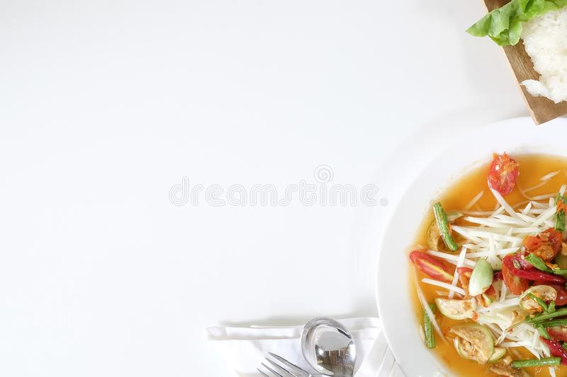 Som tam thai, green papaya salad on white table with space. stock photos