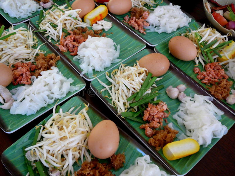 Thai food on green plates. Thai food cuisine on green china plates from cooking class in Bangkok, Thailand stock photo
