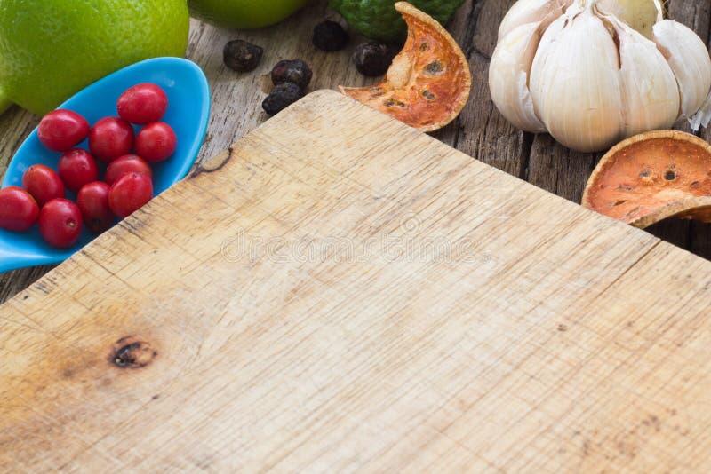 Thai food ingredients. Thai food cooking ingredients on wood background royalty free stock photo