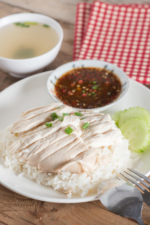 Thai food `Khao Man Kai`, Rice steamed with chicken soup and sauce. stock photography