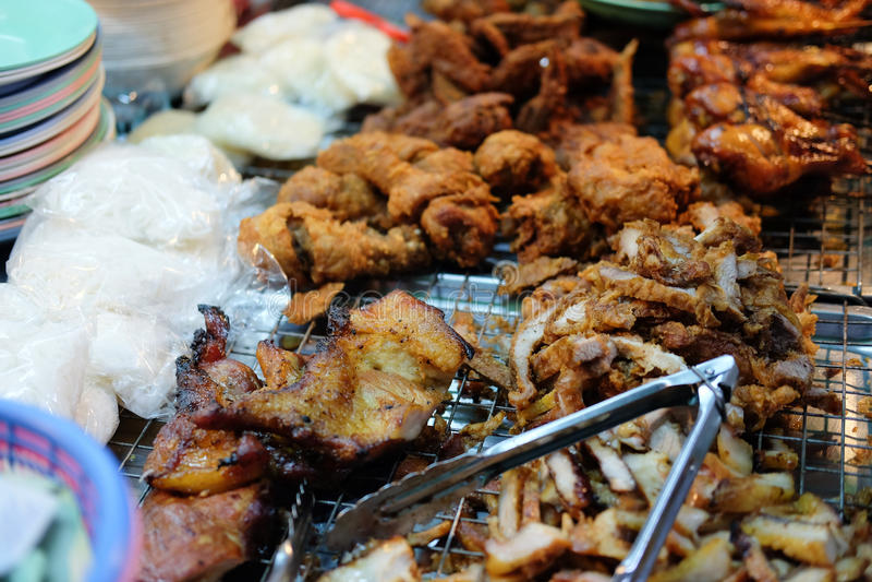 Thai food at market. Roasted spicy pork, fried pork stock image