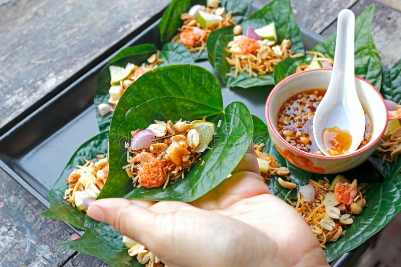 Thai Food Miang Leaf-Wrapped Bite-Size Appetizer stock photo