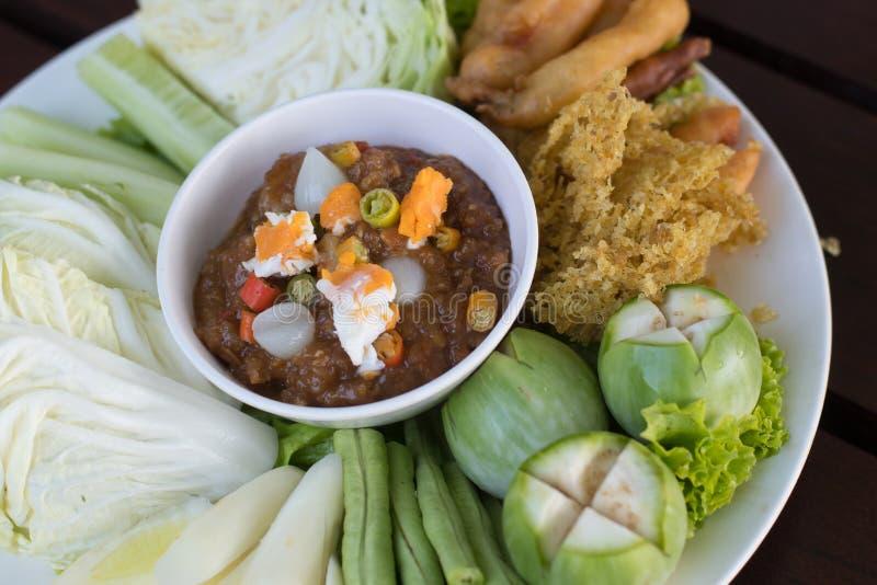 Thai food name Naam Prik Long Rau. Shrimp paste sauce with crispy fried fish and sweet pork stock photography