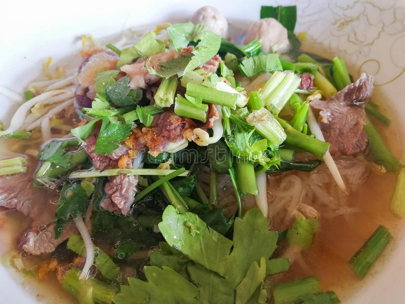 Thai food noodle soup vegetables. And meat ball stock photography
