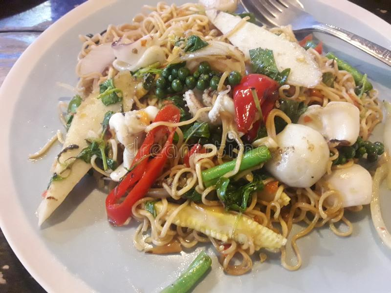 Thai food PAD KI- MAO. PAD KI- MAO thaifood Stir fried spicy thai noodle with vegetables royalty free stock photos