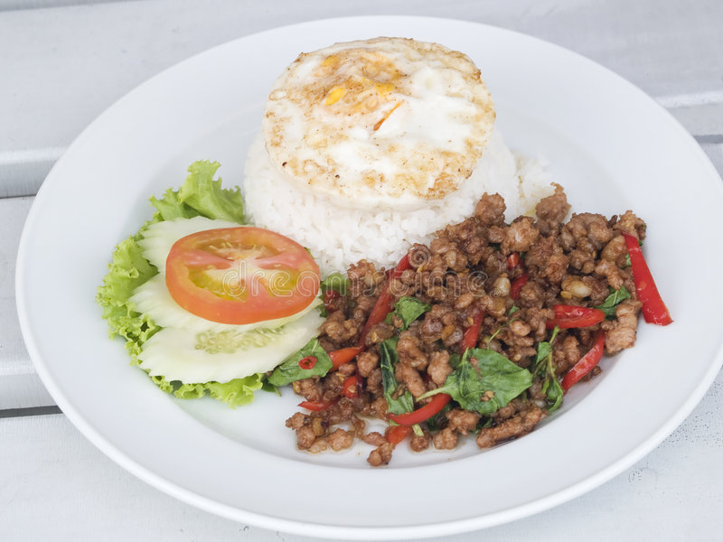 Thai food, pork with basil. Thai food, kapao moo, minced pork fried with chilli pepper and sweet basil royalty free stock images