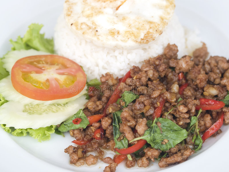Thai food, pork with basil. Thai food, kapao moo, minced pork fried with chilli pepper and sweet basil. Close-up with shallow depth of field royalty free stock images