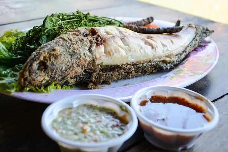 Thai food`s grill fish with spicy or Thai seafood sauce royalty free stock photo