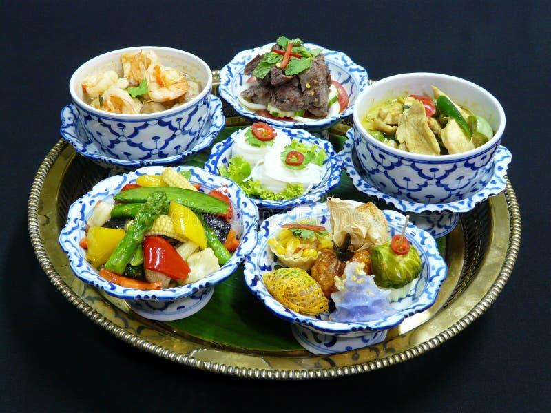 Thai food set menu. Thai mix appetizers (cho muang, rhoom, kang kao peuak, toong ngern yuang, krathong-tong, kung sorn klin), thai green curry with chicken stock photos