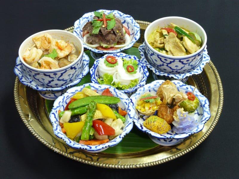 Thai food set menu. Thai mix appetizers (cho muang, rhoom, kang kao peuak, toong ngern yuang, krathong-tong, kung sorn klin), thai green curry with chicken royalty free stock images