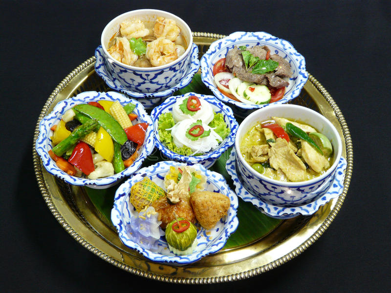 Thai food set menu. Thai mix appetizers (cho muang, rhoom, kang kao peuak, toong ngern yuang, krathong-tong, kung sorn klin), thai green curry with chicken stock image