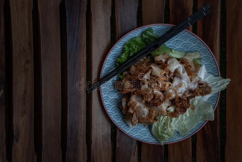 Thai food : Stir-fried Fresh Rice-flour Noodles With Chicken And Egg in a japanese dish, This easy dish is so yummy. Throw royalty free stock image
