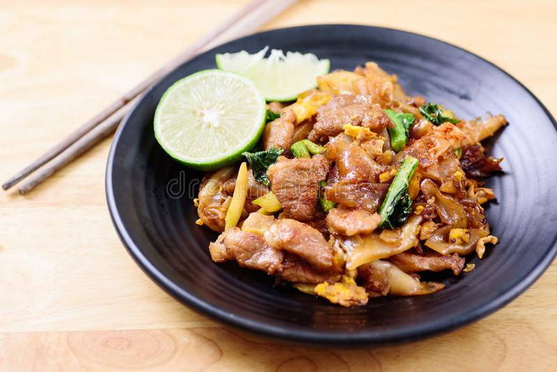 Stir-fried rice noodle with soy sauce. Thai food, stir- fried rice noodle with soy sauce Pad See Ew stock photography