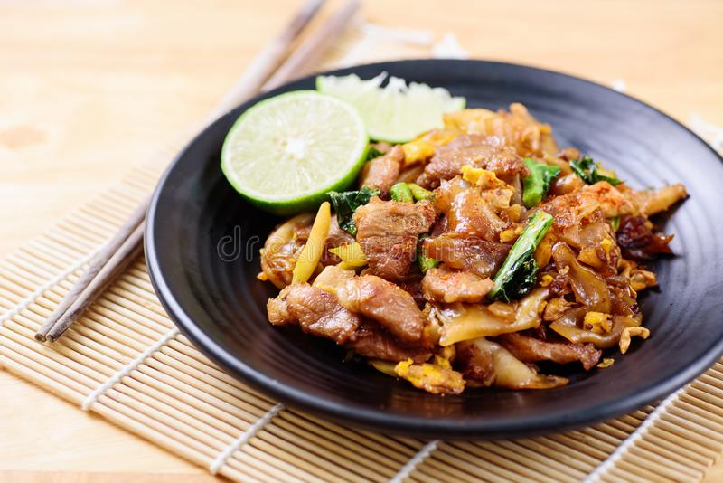 Stir-fried rice noodle with soy sauce. Thai food, stir- fried rice noodle with soy sauce Pad See Ew royalty free stock images