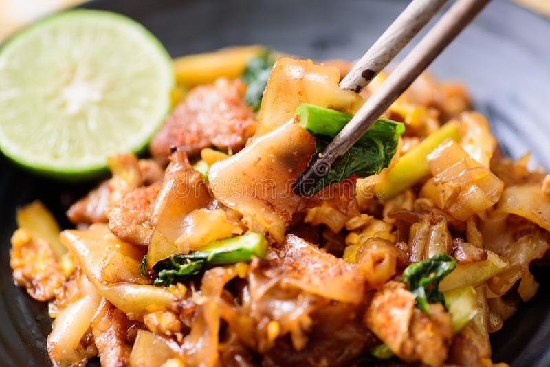 Eating stir fried rice noodle with soy sauce stock images