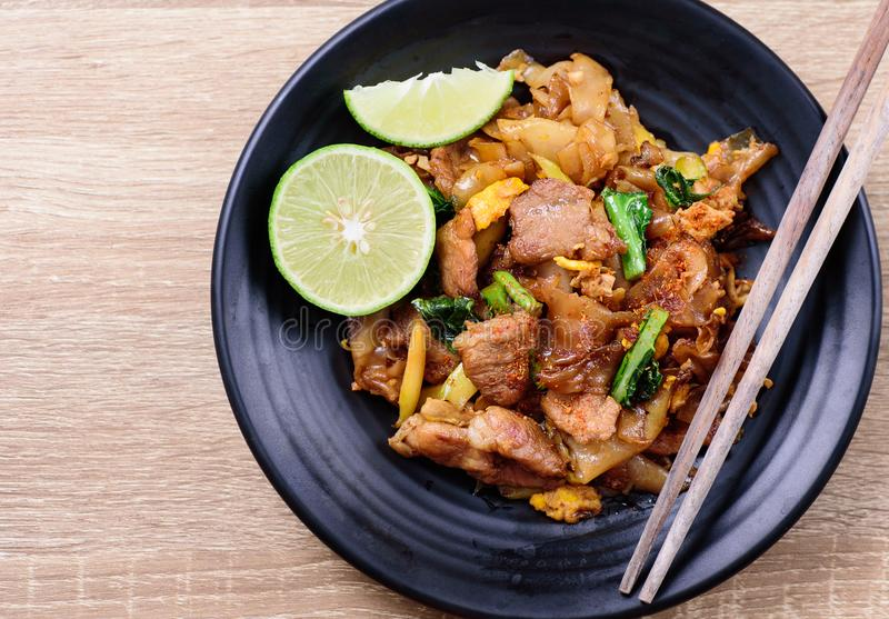 Thai food, stir fried rice noodle in soy sauce. Pad See Ew, top view of food royalty free stock photo