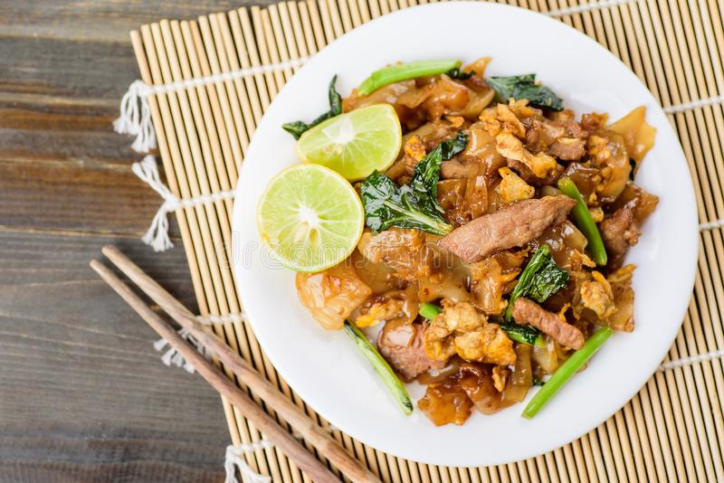 Thai food, stir fried rice noodles in soy sauce Pad See Ew. Top view of food stock photos