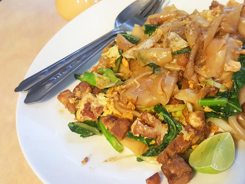 Thai food style:Pad See EiwStir fried Flat Rice Noodle with So. Y Sauce and Pork,vintage tone stock photos
