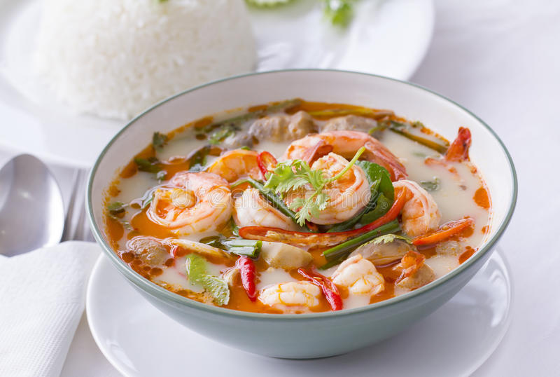 Thai Food, Tom Yam Goong, in white with steamed rice stock photography