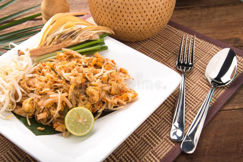 Thai Fried Noodles Pad Thai with shrimps or prawns.street food. fried noodles with chicken and shrimp royalty free stock image