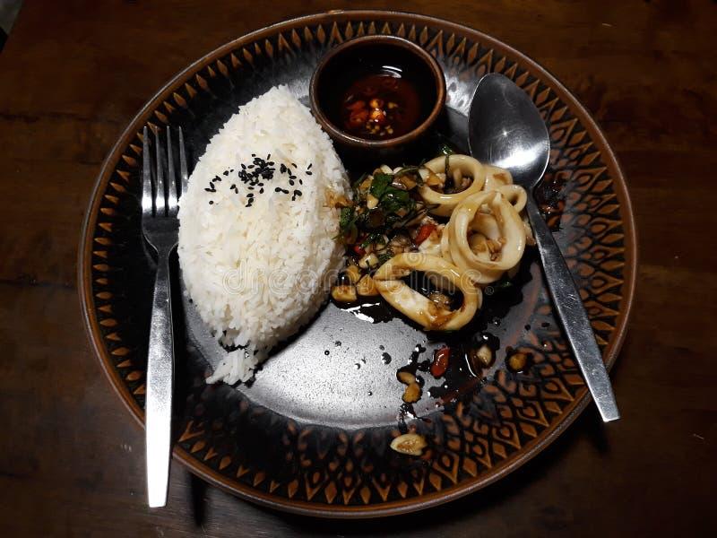 Thai Fried Squid with Basil Leaves . Thai Fried Squid with Basil Leaves royalty free stock photo