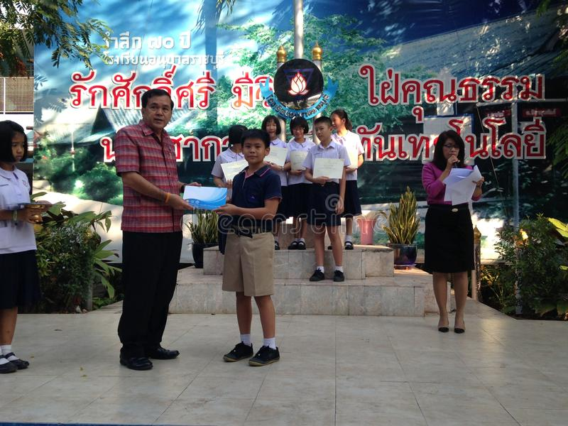 Thai primary school students in award ceremony stock photography