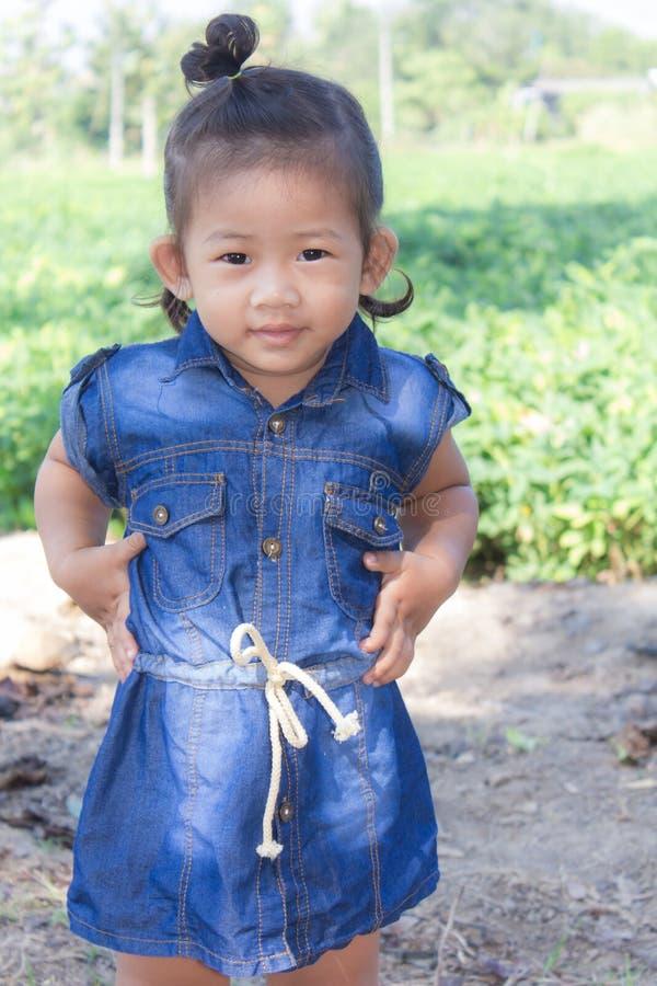 Thai girl in bean garden. Asian royalty free stock photography