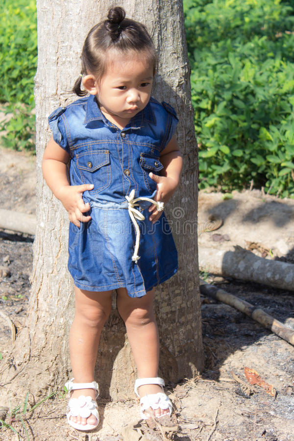 Thai girl in bean garden. Child royalty free stock photography