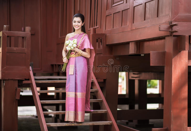 Thai girl dresses Thai traditional costume at traditional Thai royalty free stock images
