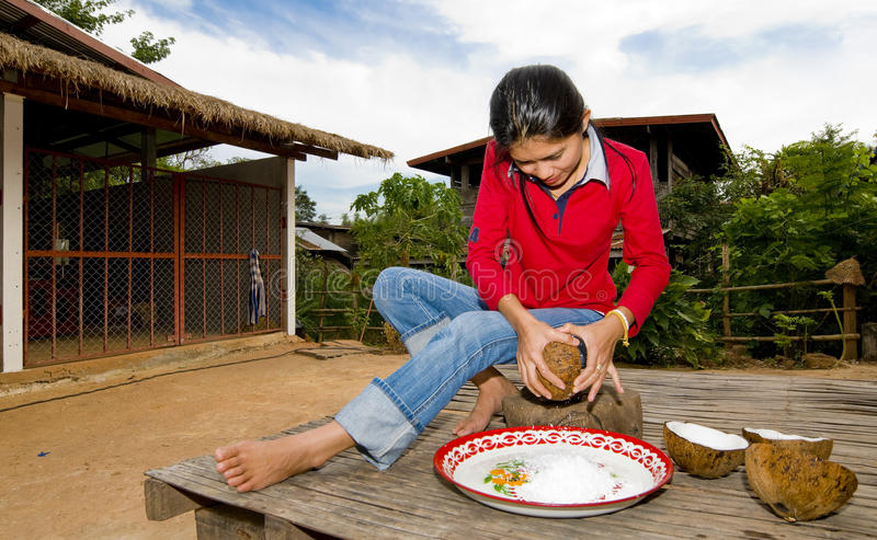 Download Thai Girl Removing Coconut Meat From Shell Stock Photo - Image: 11911834