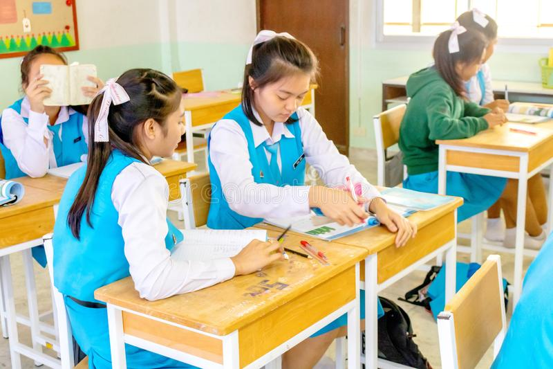 Thai girl students are studying together in their classroom in the school uniform of Wantamaria school. Pranburi, Thailand stock photos