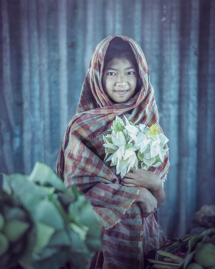 Thai Girls with lotus flower royalty free stock photography