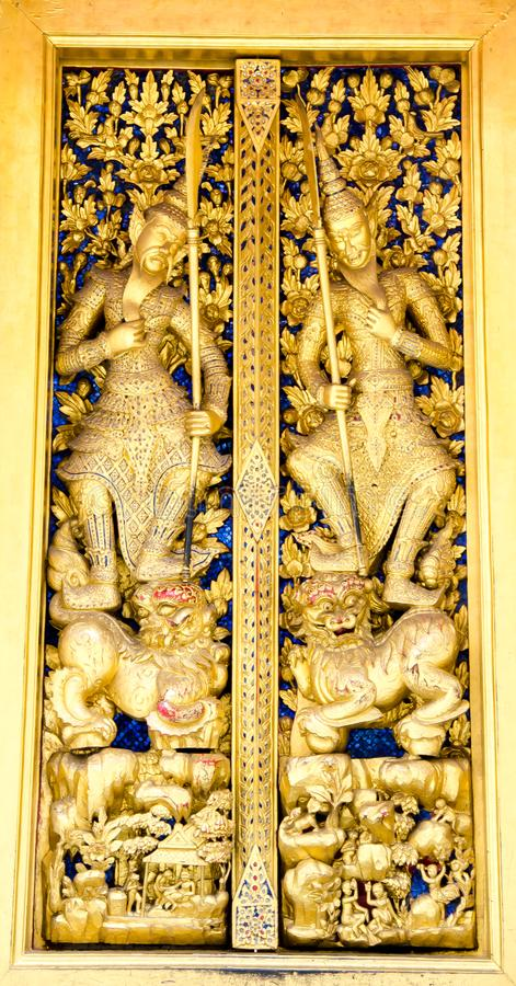 Thai Golden craving wooden doors. In the temple royalty free stock photography