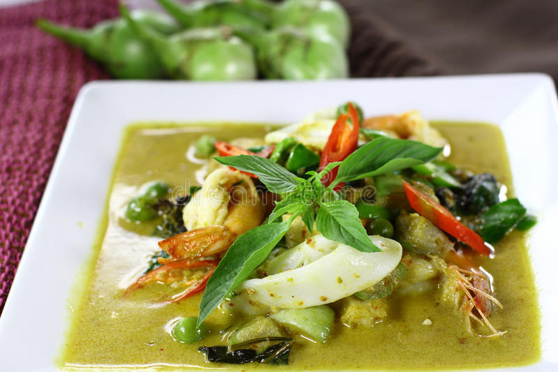 Thai green curry with shrimp and squid.  stock photo
