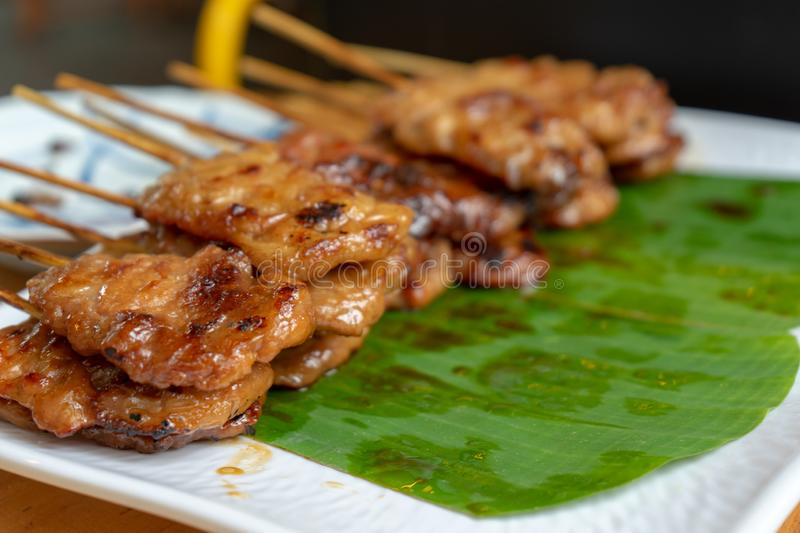 Thai grilled pork with wood stick was cooked and ready to eat royalty free stock photography