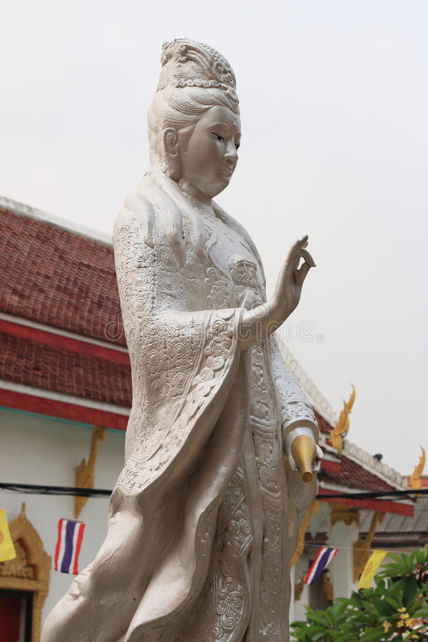 Thai Guanyin Stature. White Thai Guanyin Stature in Thai temple royalty free stock photos