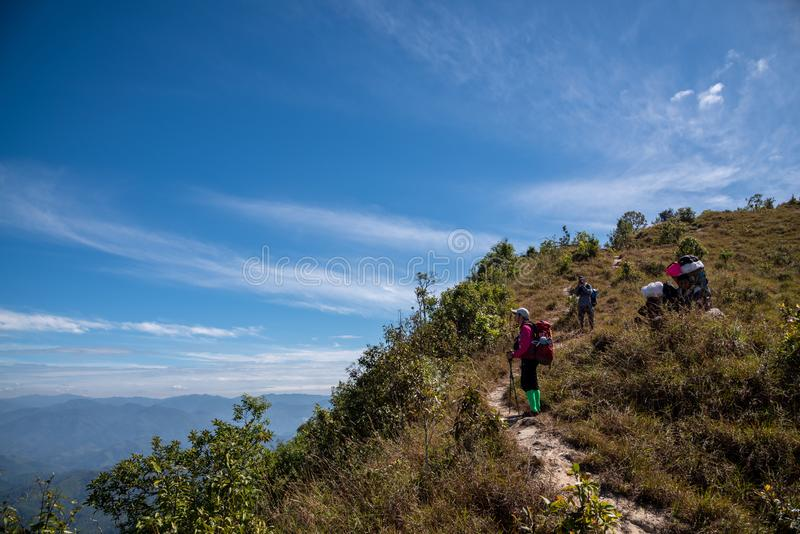 Thai hiker and porter man trekking on the mountain stock photos