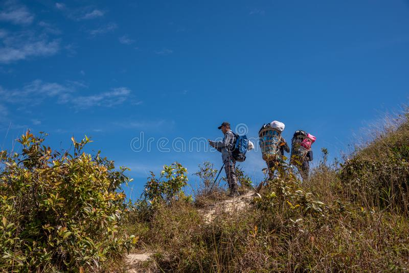 Thai hiker and porter man trekking on the mountain royalty free stock image