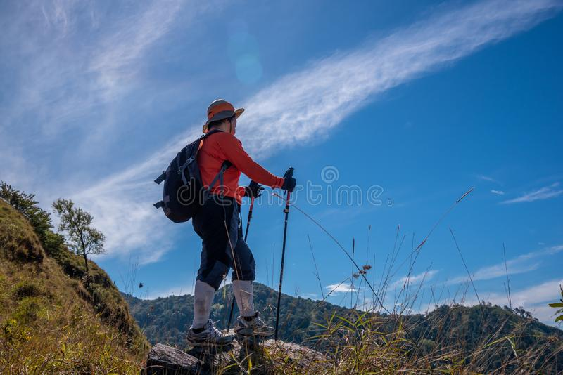 Thai hiker trekking on the mountain royalty free stock photo