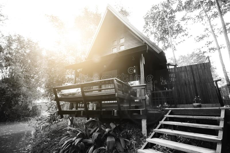 Thai house made from hard wood on river side in black and white royalty free stock photos
