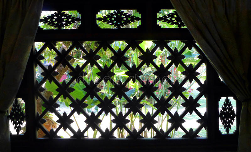Thai house window, garden view royalty free stock photography