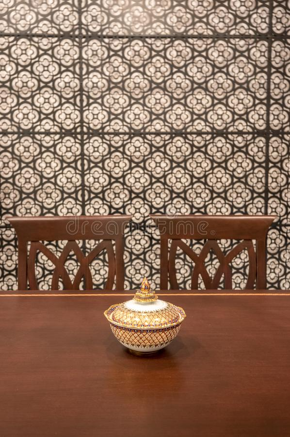 Thai interior dining table with thai culture vase royalty free stock images